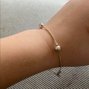 Silver bracelet with little beads on the chain